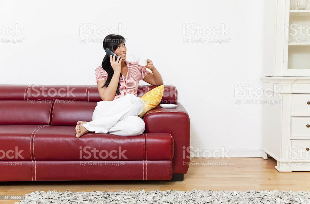 living room phoning woman with cup of coffee royalty-free stock photo