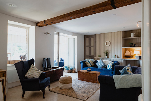 Wide shot of a cosy living room inside a holiday rental cottage in Polperro, Cornwall.
