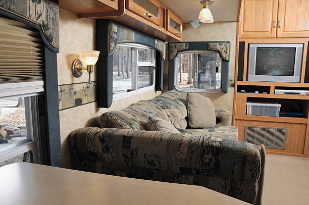 RV living room Living room in rv trailer in campground with TV on rv interior stock pictures, royalty-free photos & images