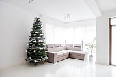 living room space, sofa and christmas tree in large suite