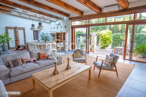 istock Living room view on to courtyard of Spanish farmhouse, Barcelona 1182598935