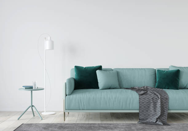 living room with a mint sofa and table stock photo