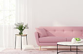 Living room with a pink sofa