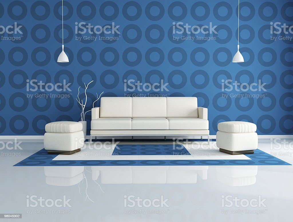 A living room with a white couch and blue wall royalty-free stock photo