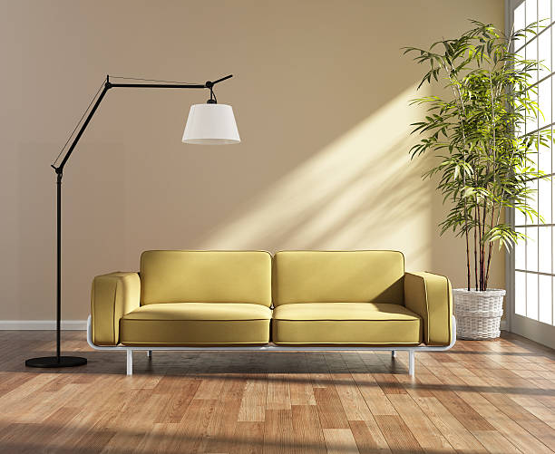Living room with a yellow sofa by the window stock photo