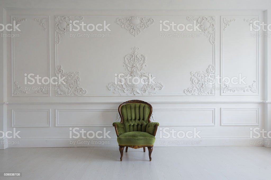 Living room with antique stylish green armchair on luxury white stock photo