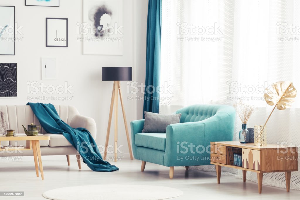 Living room with blue armchair stock photo