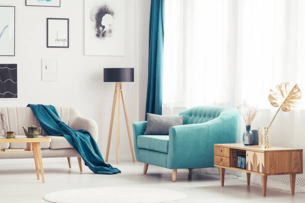 living room with blue armchair - decor stock photos and pictures