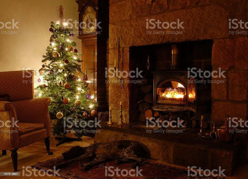Living room with Christmas tree and fireplace royalty-free stock photo
