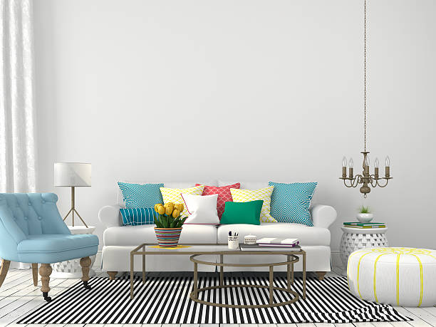 wohnzimmer mit farbenfrohen kissen - blumenstreifen stock-fotos und bilder