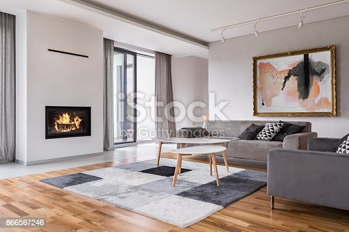 istock Living room with fireplace 866567246
