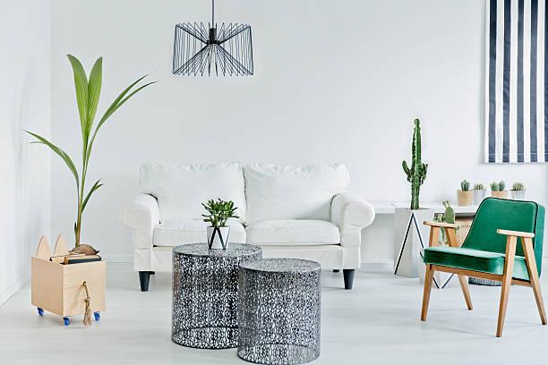 living room with green armchair - kleiner couchtisch stock-fotos und bilder