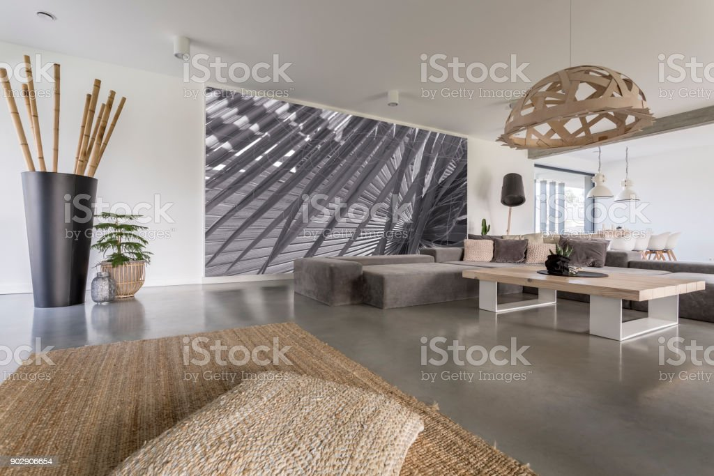 Living room with grey mural stock photo