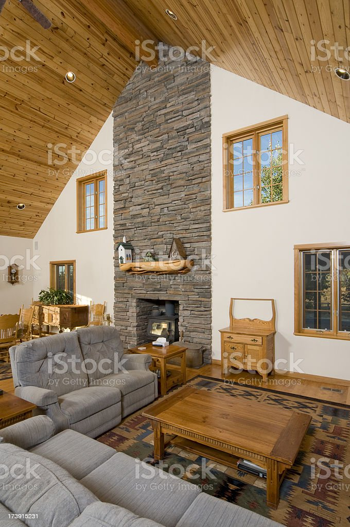 Living room with knotted pine vaulted ceiling royalty-free stock photo