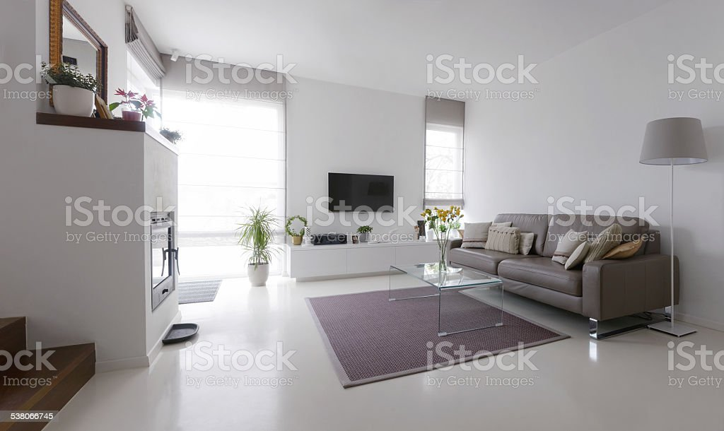 living room with leather sofa and glass table stock photo