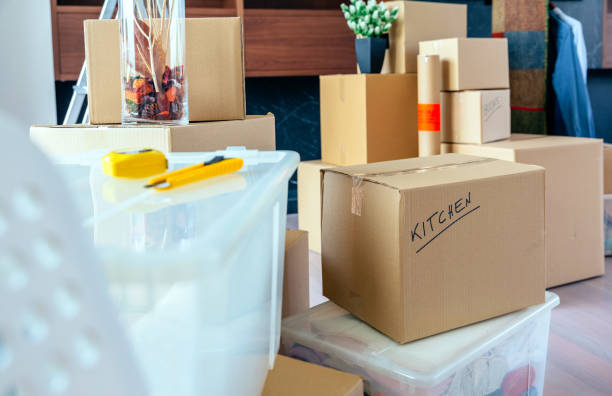 Living room with moving boxes stock photo