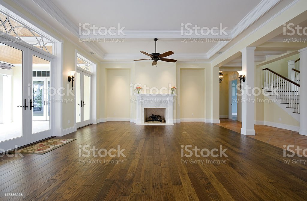 Living Room with No Furniture and Wooden Floors stock photo