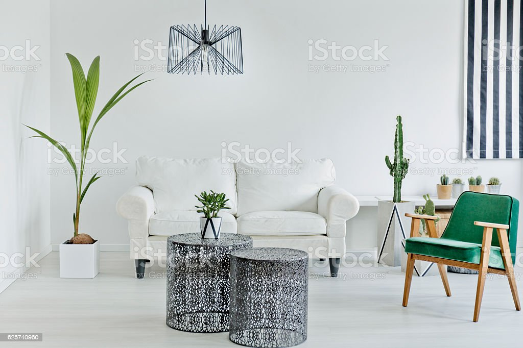 Living room with openwork table stock photo