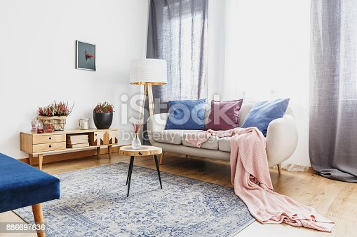 istock Living room with rustic cupboard 886697636