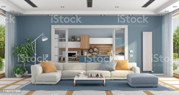 Living room with sofa and modern kitchen on background picture id1153707356?b=1&k=6&m=1153707356&s=612x612&h=n0vb otqhd1gupnxzpg8vmfm6sk6lbc5ac aqyx2xqk=