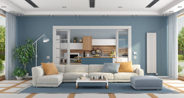 Living room with sofa and modern kitchen on background stock photo