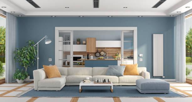 ソファーとモダンなキッチンを備えたリビングルーム - ソファ 無人 ストックフォトと画像