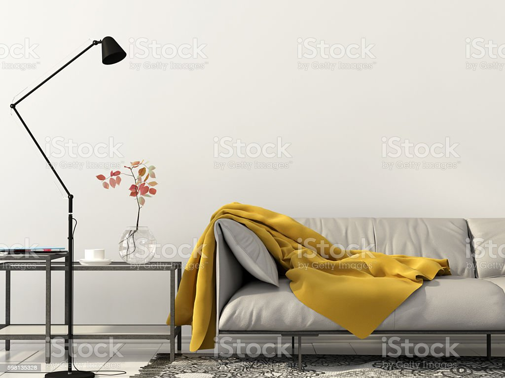 living room with white sofa with yellow blanket stock photo