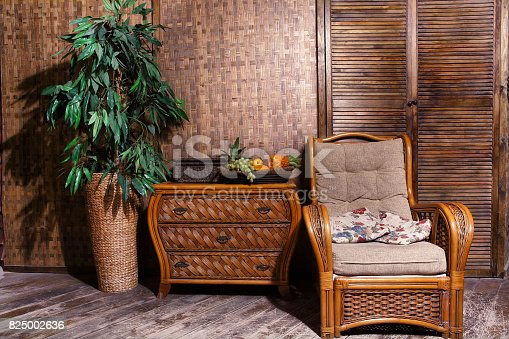1095381860 istock photo living room with wicker furniture 825002636