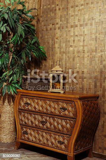 1095381860 istock photo living room with wicker furniture 825005092