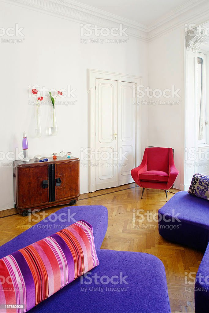 Living room with wooden floor and blue sofas stock photo