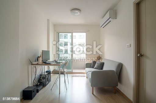 istock Living room with working area in apartment 513879684