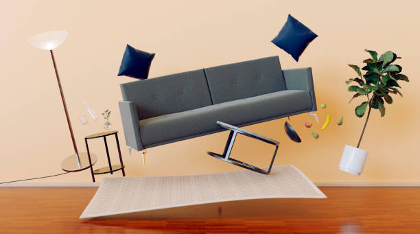 Living room with zero gravity and furniture flying through the air stock photo