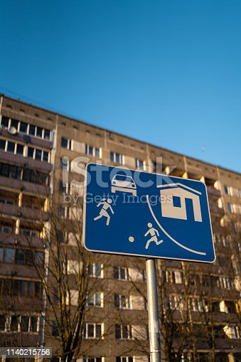 istock Living sector european road sign in Riga, Latvia with a typical soviet block of flats house building in the background 1140215756