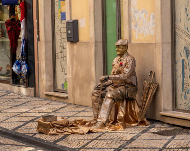 Living statue actor on the streets of Coimbra in Portugal stock photo