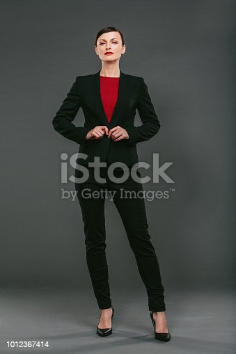 Studio portrait of a confident young businesswoman against a dark background