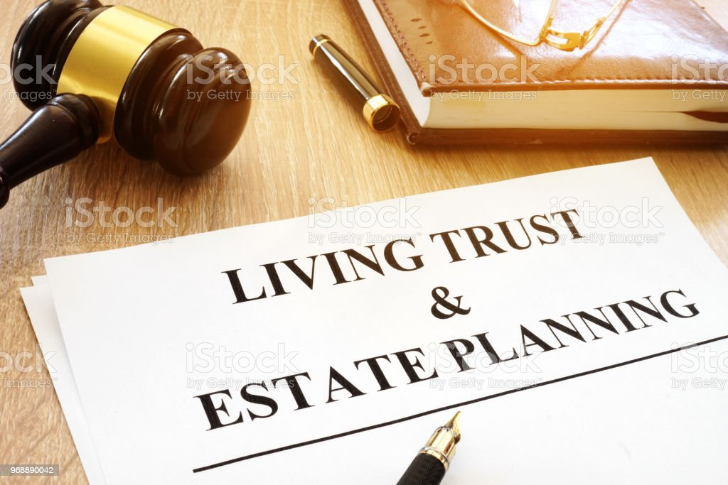 Living trust and estate planning form on a desk. - fotografia de stock