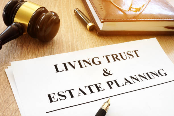 Living trust and estate planning form on a desk. stock photo