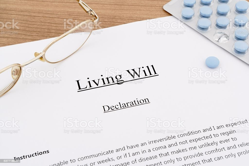 living will with pills and eyeglasses stock photo