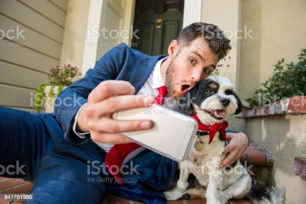 Living with pets businessman taking selfie with his dog picture id841761986?b=1&k=6&m=841761986&s=612x612&h=mrb2ogn77fb8iutndsuymbw7rg6cf zq0orqr4hguru=