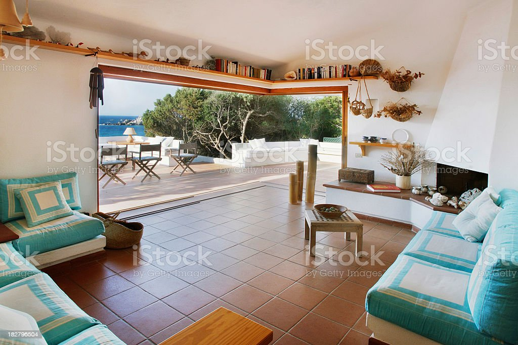 Living-room and terrace with earthenware floor of Sardinia seaside house stock photo