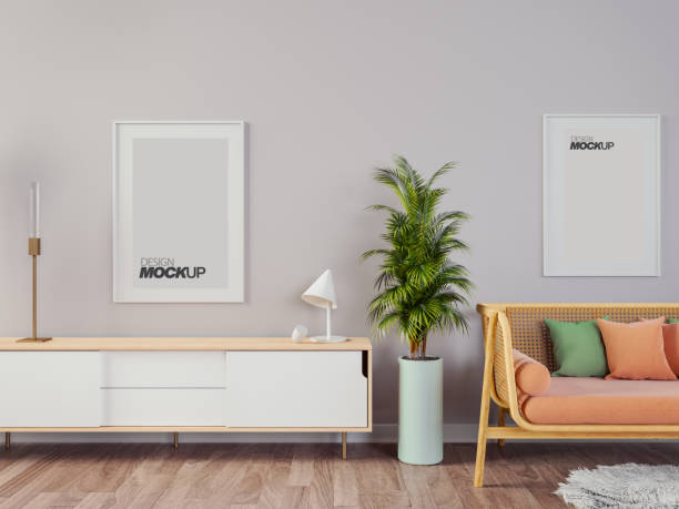 Livingroom interior wall mock up with gray fabric sofa and pillows on white background with free space on right. stock photo