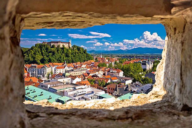 Ljubljana aerial view through stone window Ljubljana aerial view through stone window, capital of Slovenia ljubljana stock pictures, royalty-free photos & images