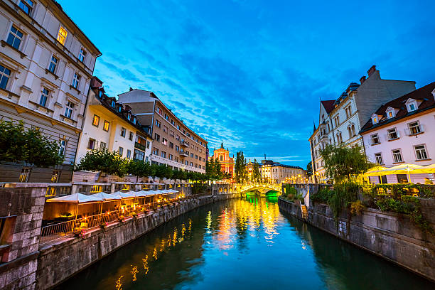 Ljubljana and Ljubljanica river at dusk Ljubljana and Ljubljanica river at dusk. ljubljanica river stock pictures, royalty-free photos & images