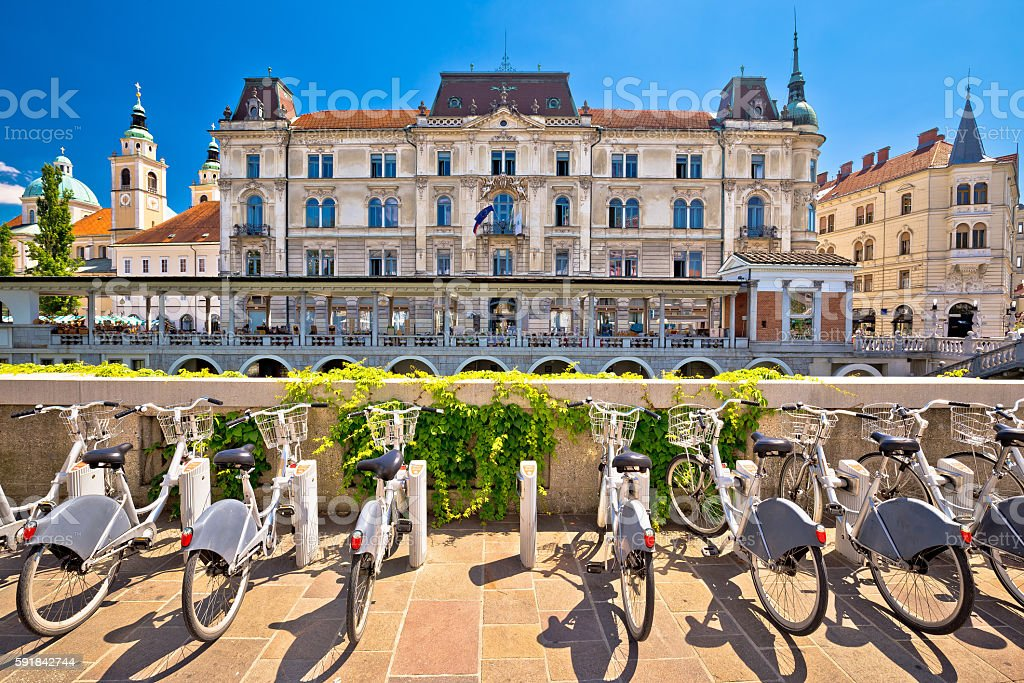 Ljubljana architecture and tourist bikes stock photo