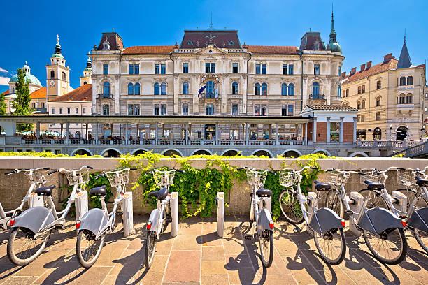 Ljubljana architecture and tourist bikes Ljubljana architecture and tourist bikes, capital city of Slovenia ljubljana stock pictures, royalty-free photos & images