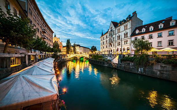 Ljubljana at dusk Evening shot of Ljubljanica river ljubljana stock pictures, royalty-free photos & images
