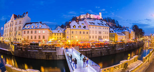 Ljubljana in Christmas time. Slovenia, Europe. Ljubljana in Christmas time. Lively nightlife in old medieval city center decorated with Christmas lights. Slovenia, Europe. Shot at dusk with fish eye lens. ljubljana castle stock pictures, royalty-free photos & images