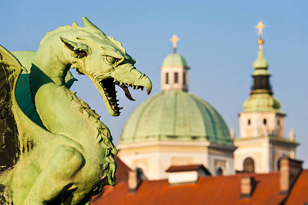 Ljubljana Dragon statue and cathedral in Ljubljana, Slovenia ljubljana stock pictures, royalty-free photos & images