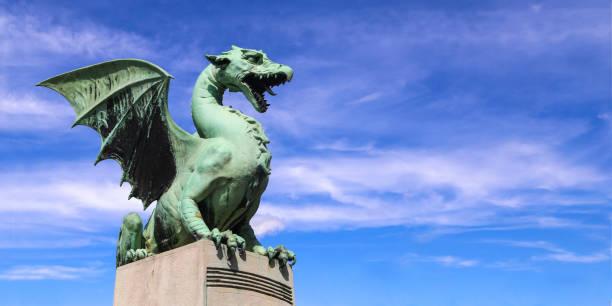 Ljubljana Dragon statue on famous Dragon bridge (Zmajski most) in Ljubljana, Slovenia. ljubljanica river stock pictures, royalty-free photos & images