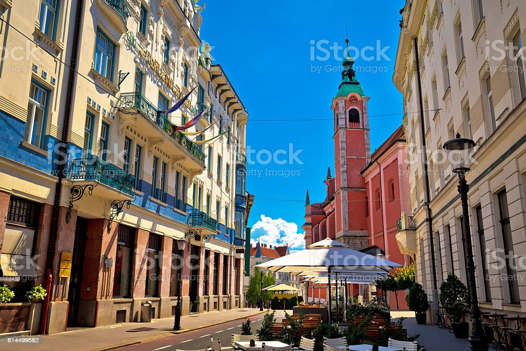 Ljubljana street view with cafe and church stock photo